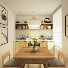 meble kuchenne z naturalnego drewna,biała cegła na ścianie,biało-czarne plakaty i czarne dodatki w skandynawskim stylu (26854)