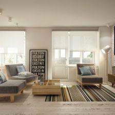 deski podłogowe z naturalnbego drewna,biała cegła na ścianie,drewniane fotele z szarą tapicerką w tkaninie i tkany dywan w paski w salonie (26856)